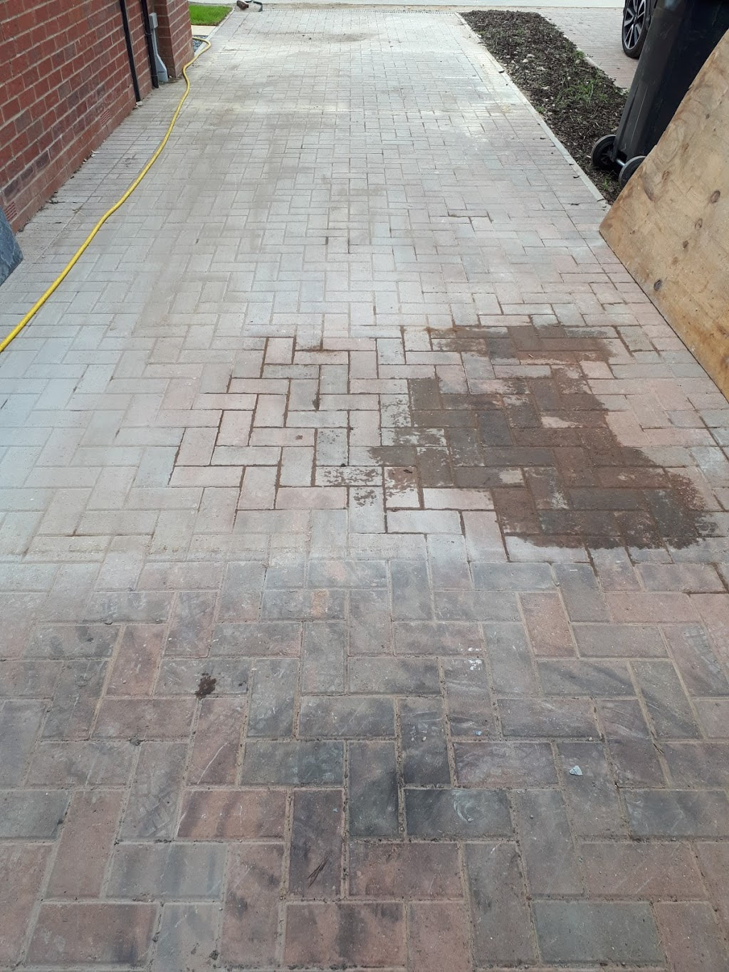 Block paving before being professionally cleaned