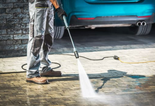 Professional cleaning of driveway with pressure washer